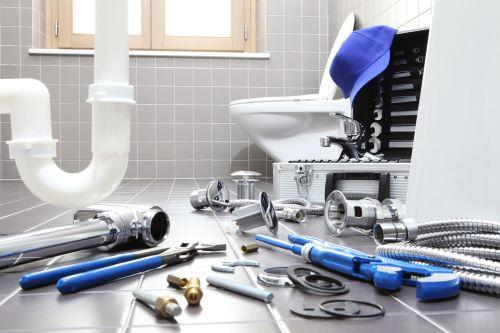 plombier Nancy - des outils de plomberie sont posés au sol
