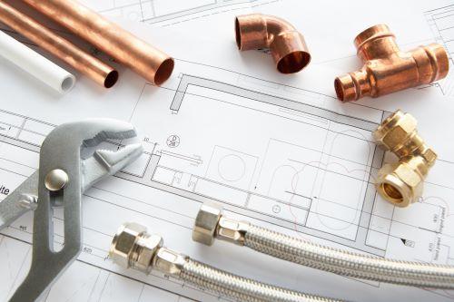plombier Noisy-le-Grand - un ensemble d'outils sur un plan d'architecte