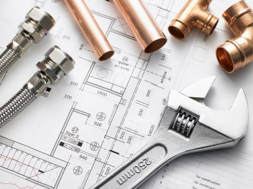 plombier Rueil-Malmaison - des plans d'architecte et des éléments de plomberie