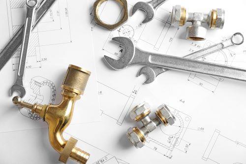 plombier Chatou - un ensemble d'outils sur des plans